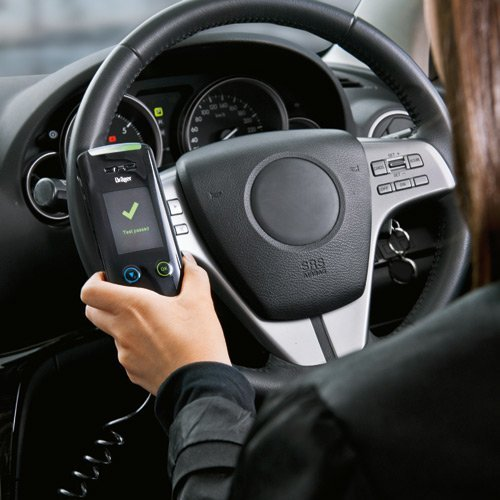 Driver holding Drager interlock breathalyzer